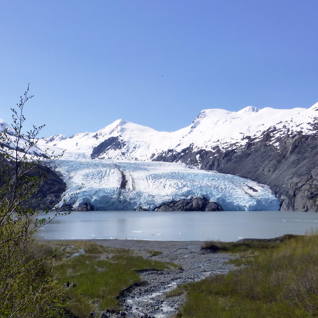 a body of water in front of portage glacier