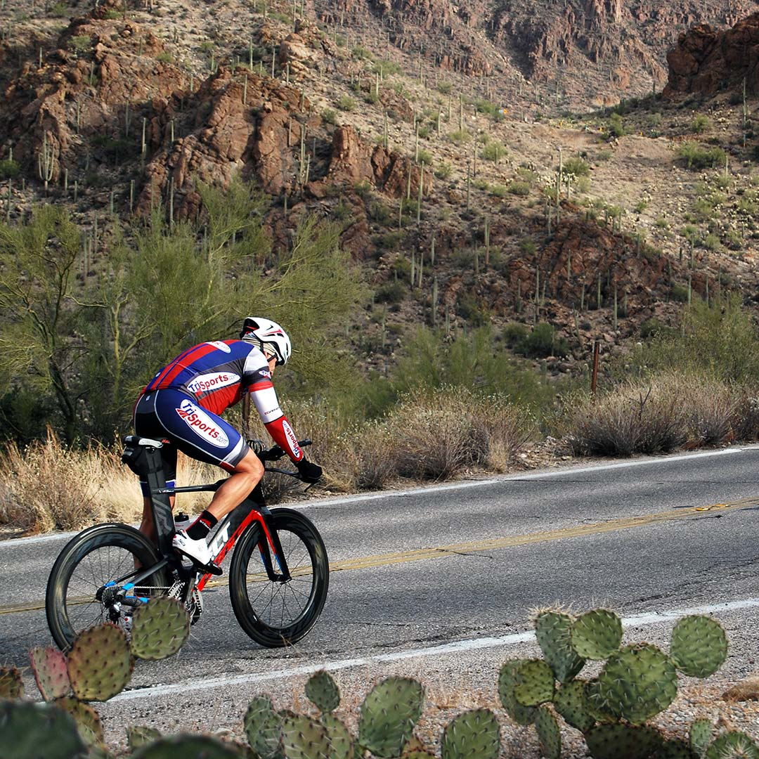 A cyclist riding in Tucson Mountain Park. Photo © Tim Hull.